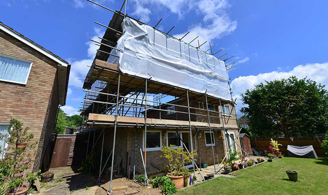 House side and rear extension work is under construction