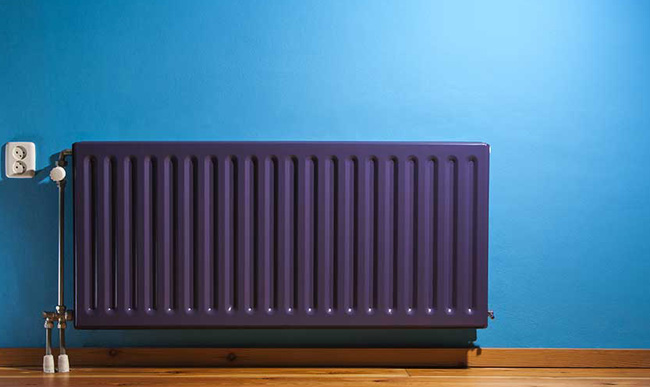 Designer Radiator placed on a blue wall.