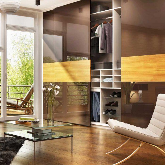 Luxurious bespoke brown coloured wardrobes.