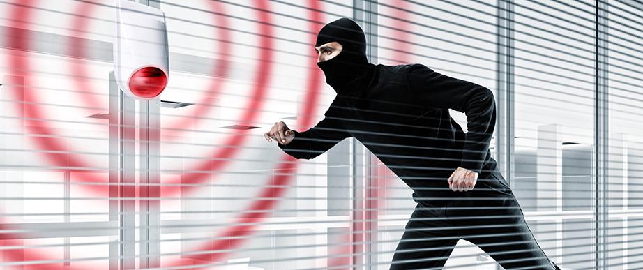 Burglar trying to break and enter.