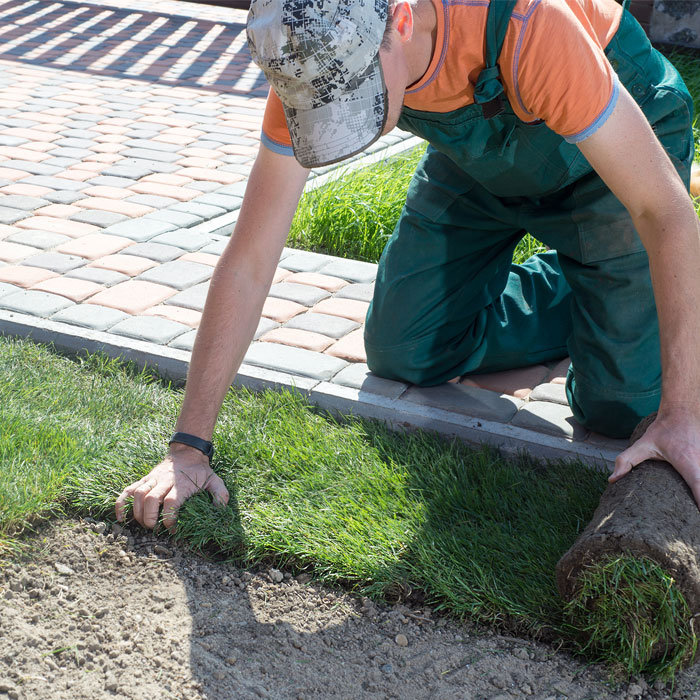 TEL constructions worker doing landscaping and gardening work.